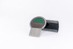 Louse comb for lice treatment, metal and plastic. Stock Photo