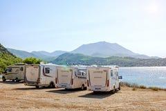 04/09/2018 - Loutraki / Greece: Rest on the beach, in the houses on wheels. Vuligmeni Sea Lake stock photos