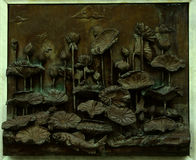 Lotuses on bas-relief at the Wat Tramit wall Stock Images