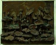Loutses su bassorilievo alla parete di Wat Tramit Immagini Stock