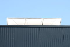 Louver. The open ventilation flap a sheet hall against the sky seen Stock Photo