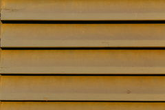 Louver window slats. Horizontal slats of a wooden louver window Royalty Free Stock Image