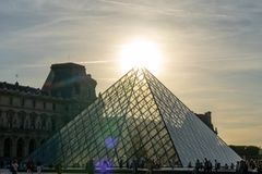 Louvre building pyramid in paris france royalty free stock image