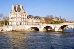 Louvre. View of the Louvre Museum, across the Seine River, Paris, France Royalty Free Stock Images