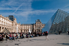 Louvre. People enjoying the sun at the Louvre Royalty Free Stock Photos
