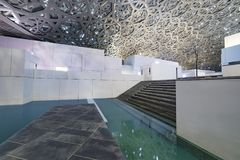 Louvre, Interior 2, Abu Dhabi, Emirates, Dec.2017. Louvre, Abu Dhabi, United Arab Emirates - Dec.29, 2017: recreation area with a terrace and a pool under an Stock Photos