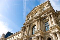 Louvre building on blue sky background Stock Photo