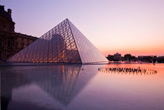 Louvre at dusk Stock Images