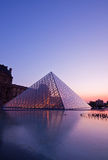 Louvre at dusk Stock Photos