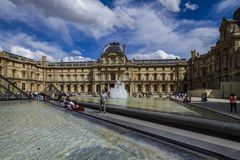 Louvre facade in Paris royalty free stock photo