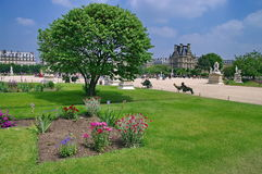 Louvre Palace and the gardens - landmark attraction in Paris, France Stock Images