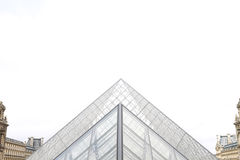 Louvre glass pyramids - symmetrical view stock photos