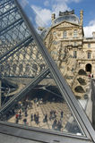 Louvre Museum. The glass pyramid of the Musée du Louvre in Paris with the Richelieu Wing in the background royalty free stock photography