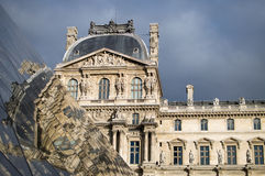 Louvre Museum. The Richelieu Wing reflected in the glass pyramid of the Musée du Louvre in Paris stock photos