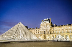 Louvre museum. PARIS - AUGUST 18: Louvre museum at sunset on August 18, 2012 in Paris. Annual Summer Exhibition at Louvre Stock Photo