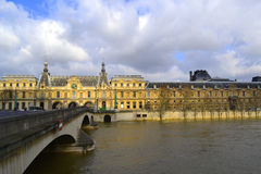 Louvre Museum Across the Seine River Stock Photo