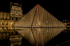 Louvre Museum Glass Pyramid at Night. Glass pyramid in front of the Louvre Museum, Paris. Night lights stock photos