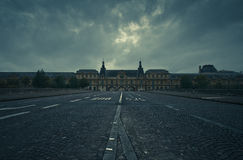The Louvre museum as viewed from the Pont du Carrousel Royalty Free Stock Images