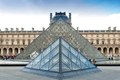 Louvre Museum building and Pyramid in Paris, France Stock Image