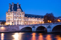 Louvre Museum at dusk. View of the Louvre Museum at dusk, across the Seine River, Paris, France Stock Image