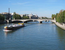 The Louvre Museum& Eiffel Tower at the Seine River. View of the Louvre Museum and Eiffel Tower from Bridge across the Seine River in Paris, France Stock Images