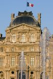 Louvre museum and fountains - France - Paris. Louvre museum fountains at sunset - France - Paris stock photography
