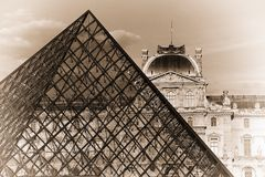 Louvre Museum. FRANCE. PARIS - JUNE 25, 2015: View on the Louvre Museum and the glass pyramid on a summer evening in retro style Stock Photos