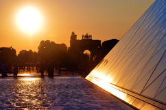 The Louvre museum in France at sunset Stock Images