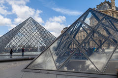Louvre Museum with Glass Pyramids, Famous Landmark in Paris France Royalty Free Stock Photos