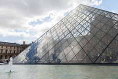 Louvre Museum with Glass Pyramids, Famous Landmark in Paris France Stock Photos