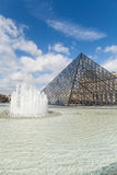 Louvre Museum with Glass Pyramids, Famous Landmark in Paris France Stock Photo