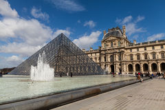 Louvre Museum with Glass Pyramids, Famous Landmark in Paris France Royalty Free Stock Photo
