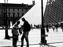 Louvre museum, immigrant selling souvenir Royalty Free Stock Photography