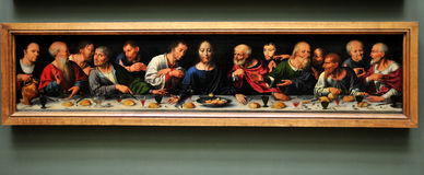 Louvre museum -  Joos van Cleve -. The Lord's Supper and Last Supper, Joos van Cleve (Dutch artist, 1485-1540), The Last Supper, oil on wood, full size 45 x 206 Royalty Free Stock Image