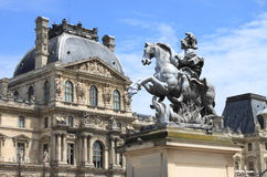 Louvre Museum and the Louis XIV Equestrian statue Royalty Free Stock Photography
