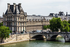 Louvre Museum Musee du Louvre and Pont Royal bridge. Paris, Fr. View of the Louvre Museum Musee du Louvre and Pont Royal bridge over Seine River. Louvre Museum Stock Images