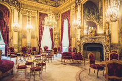 Louvre Museum Napoleon Apartments. Interior of the Napoleon apartments in the french Louvre museum of Paris. Rich designed interiors with royal furniture stock image