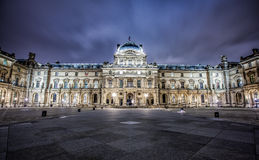 Louvre Museum at night. PARIS - JANUARY 4: Louvre Museum and Pyramid at night on January 4, 2013 Royalty Free Stock Photo