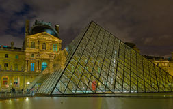 Louvre museum at night, Paris, France Stock Photos