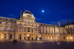 Louvre Museum at night in Paris, France Stock Photo