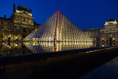 Louvre Museum by Night Stock Images