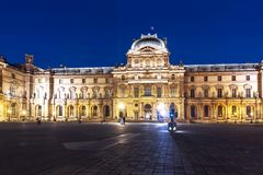 Louvre museum at night, Paris, France stock photography