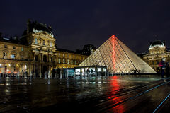Louvre museum at night Stock Photo