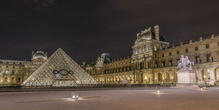 Louvre Museum at night Royalty Free Stock Image