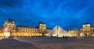 Louvre museum at night in Paris Royalty Free Stock Photos