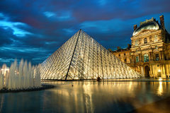 The Louvre museum at night in Paris Royalty Free Stock Image
