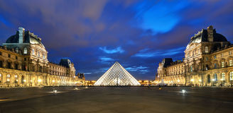 The Louvre museum at night in Paris Royalty Free Stock Images