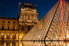 Louvre Museum at night Stock Images