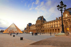 Louvre Museum Paris. The most visited museum in the world, Louvre in Paris, France magnificent illuminated at twilight. Its history goes back 800 years of