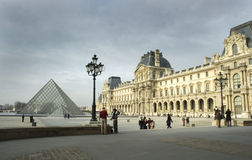 Louvre Museum in Paris. Wide angle exterior shot of the Louvre Museum in Paris. 18th Century France architecture looks onto the 20th century structure royalty free stock photos
